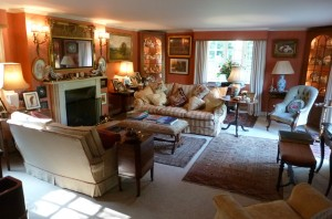 Our guests can relax in the sitting room with its log fire, fine antiques, big comfy sofas